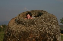 Max trying to look cute and cuddly in the largest jar from the Plain of Jars!!
