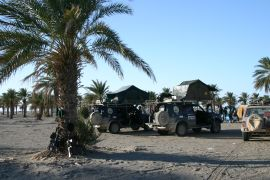 Campsite and guns, Balochistan, Pakistan